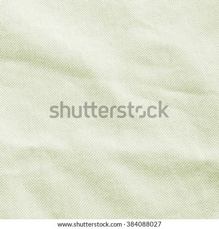 Abstract crumpled old light green colors fabric texture backgrounds : creased fabric garment texture in bright beige olive color tone.square frame plain - stock photo