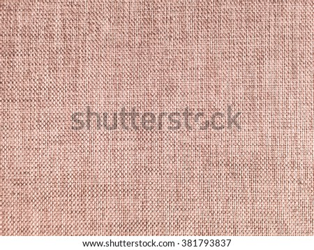 Abstract crumpled red tan brown color fabric texture background:rough/creased fabric textures in vintage color.wrinkle fabric burlap backdrop concept.tan garment textile wallpaper for banner template - stock photo