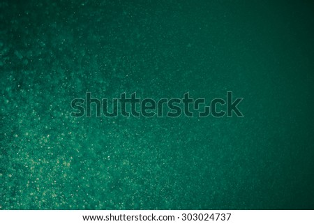 abstract dark bokeh lights background ,  defocused background, glowing galaxy - stock photo