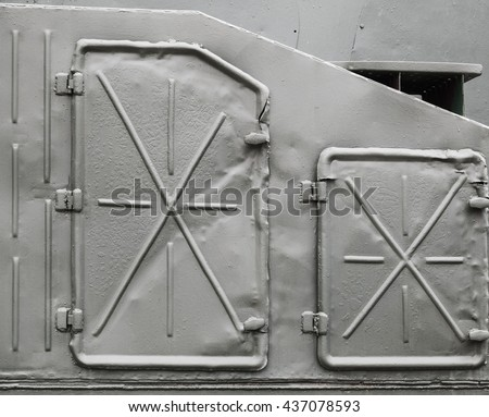 Abstract dark gray industrial metal background texture with manholes, details of Russian armored train from WWII time - stock photo