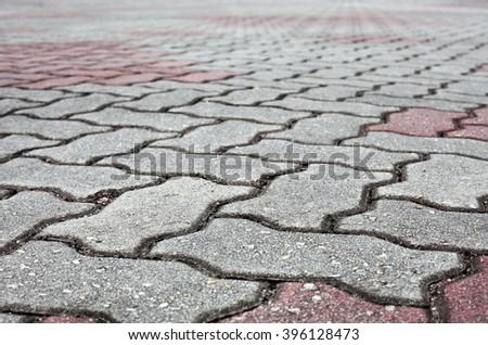 Abstract decorative concrete block pavement vanishing into the horizon.  - stock photo