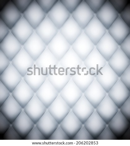 Abstract decorative surface of used natural luxury modern style leather with rhombs. Classic light white and dark gray grungy rich skin of retro wall, door, sofa, studio interior with metal buttons. - stock photo
