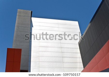 Abstract detail of modern building over blue sky as background - stock photo