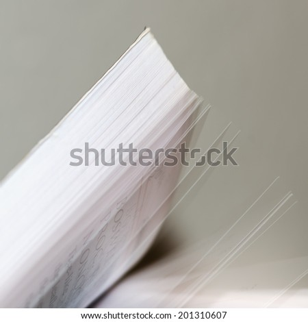 Abstract detail of pages of a book turned over. - stock photo