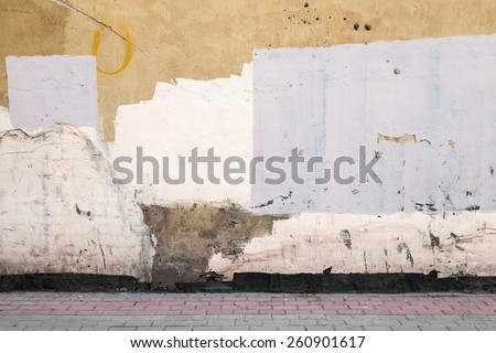 Abstract empty abandoned urban courtyard fragment, old colorful wall and road pavement - stock photo
