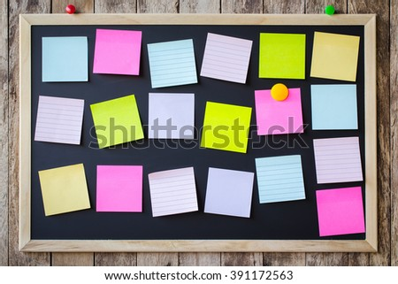 Abstract empty Blank chalkboard magnet with paper note and sticker note in wooden frame isolated on wooden background. empty space for add text. - stock photo