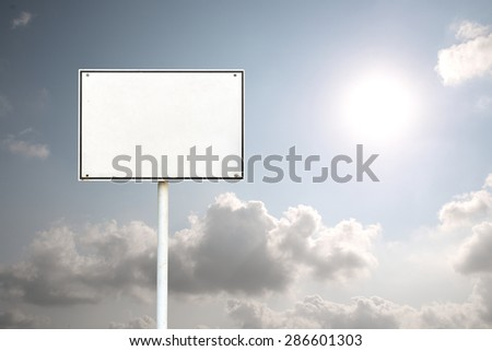 Abstract empty rectangular white sign over bright sky with round big sun copy space - stock photo