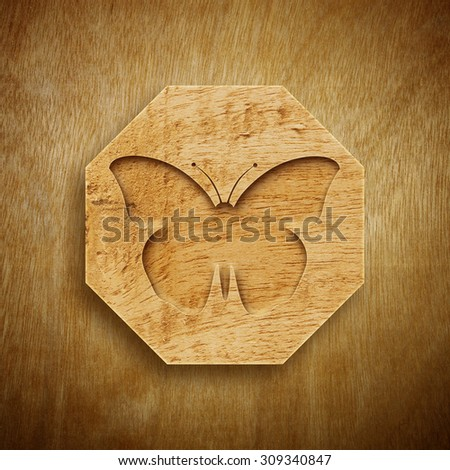 Abstract Engraved design of Butterfly with Wood texture. - stock photo