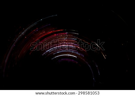 Abstract Fairy Lights Speed Motion On Black - stock photo