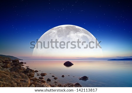 Abstract fantastic background - dark blue sky, smooth serene sea, full moon and stars in space. Elements of this image furnished by NASA - stock photo