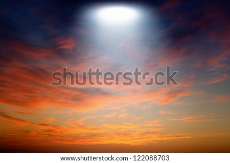 Abstract fantastic background, red sunset, bright spotlight from above looks like ufo - stock photo
