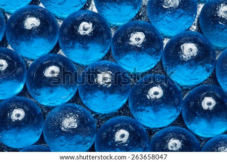 Abstract fantastic texture of colored glass beads - stock photo