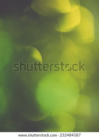 Abstract Festive background. Christmas and New Year feast bokeh background with copyspace. Holiday party background with blurry boke special magic effect.. Vintage photography effect. - stock photo
