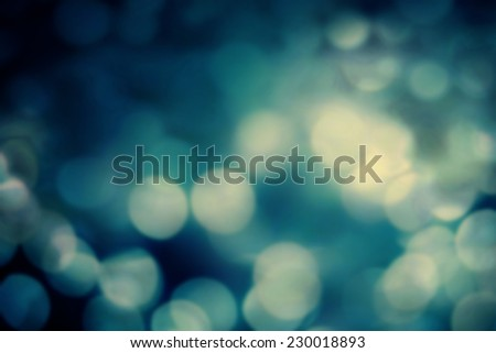 Abstract Festive background. Glitter vintage lights background with gold and black lights, defocused. Christmas and New Year feast bokeh background with copyspace. - stock photo