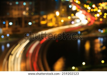 Abstract festive curves of bridges background with bokeh defocused lights of downtown of Ho Chi Minh City ( Sai Gon ) , Vietnam from high view at in sunset or sunrise - stock photo
