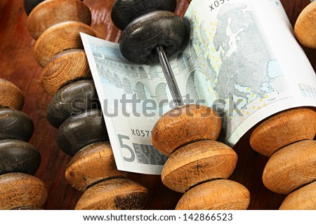 Abstract financial concept. Euro and abacus - stock photo
