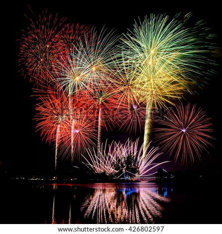 abstract Fireworks light up the dark sky background - stock photo