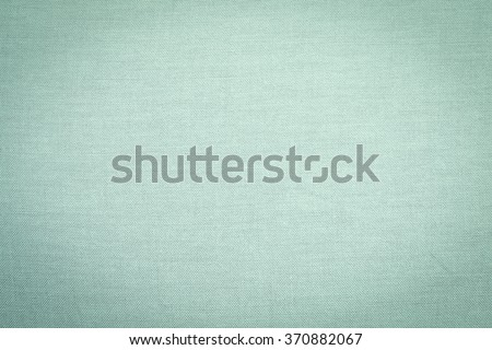 Abstract flat green olive color fabric textile texture background:detail of plain burlap backdrop:rustic seamless pattern canvas structure clothing concept:brown color of linen wallpaper picture - stock photo