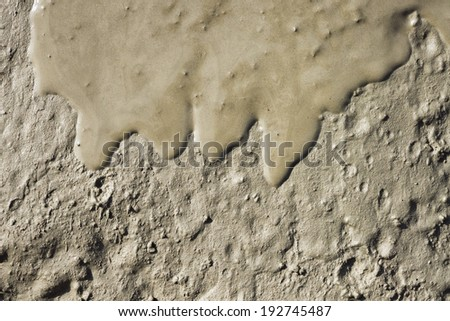 Abstract flowing wet mud close up texture. Useful for background. - stock photo