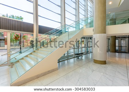 Abstract fragment of architecture of modern lobby, hallway of the luxury hotel, shopping mall, business center in Vancouver, Canada. Interior design. - stock photo
