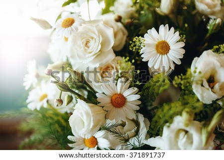 Abstract Fresh Bouquet of White Roses and Chamomile Close Up. Selective Focus, Shallow Depth of Field. - stock photo