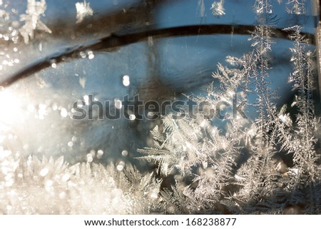 Abstract Frosty Textures on Window. Winter Ice Background with Shiny Bokeh. - stock photo