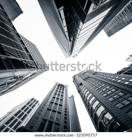 Abstract futuristic cityscape view with modern skyscrapers. Hong Kong - stock photo