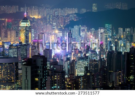 Abstract futuristic night cityscape with illuminated skyscrapers. Hong Kong aerial view panorama - stock photo