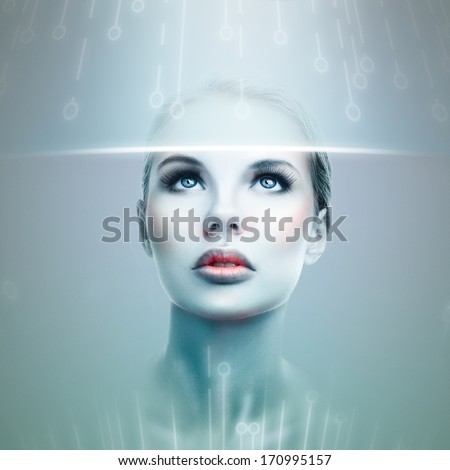 Abstract futuristic woman looking at data flow in a virtual display - stock photo