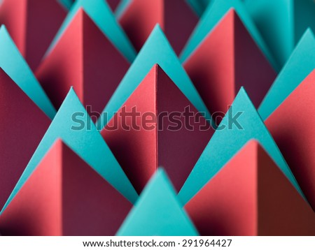 abstract geometrical background with colorful paper pyramids. selective focus - stock photo
