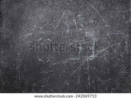 Abstract Gray  background with spotlight and scratches. Dark grunge textured wall closeup for design. Grungy  blackboard. - stock photo