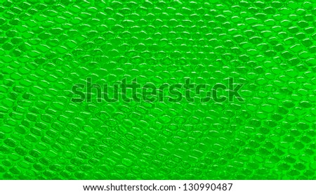 Abstract green snakeskin leather, pattern background - stock photo