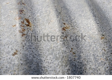Abstract grunge background of a section of a weathered and starting to rust drainage pipe - stock photo