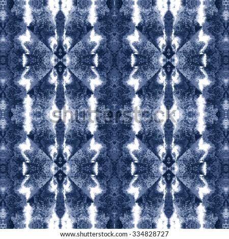 Abstract grunge indigo kaleidoscope space dye.  Seamless pattern. - stock photo