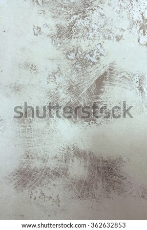 Abstract grunge texture with scratches and a piece of paint. Grey street wall background. Grunge texture perfect for aged effect. Old dirty texture for your design - stock photo