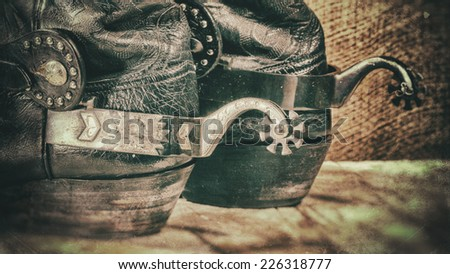 Abstract grungy western backgrounds with cowboy boots - stock photo