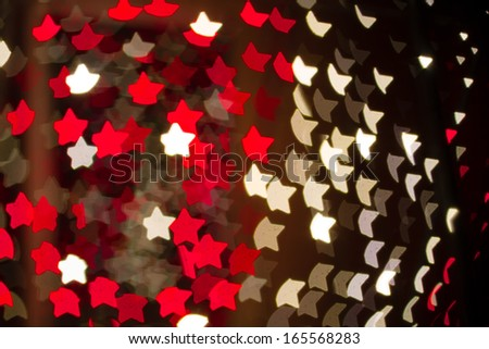 Abstract heart shaped bokeh background of red and white Christmas lights - stock photo