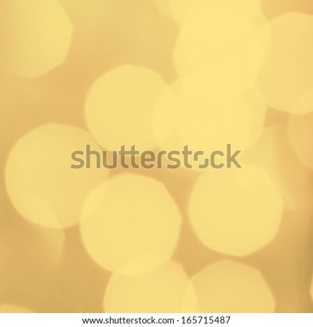 Abstract holiday background. Vintage lights, glowing magic bokeh, retro style. Dark yellow lights with blur effect. - stock photo