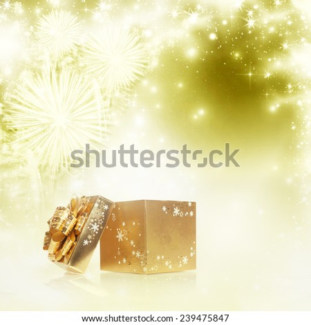 abstract holiday background with golden gift box and fireworks - stock photo