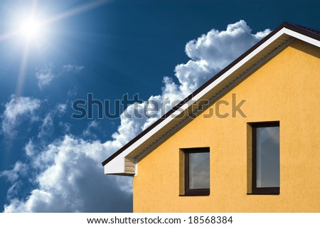 Abstract house facade under the blue sky - stock photo