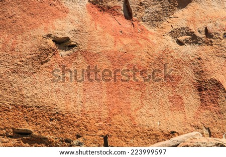 Abstract human art at Pha Taem prehistoric cliff painting which date back three thousands to four thousands years before history,Pha Taem National Park Ubon Ratchathani  (Ubolratchathani) Thailand  - stock photo