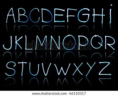 abstract illustration of the alphabet created with light - stock photo
