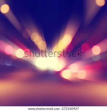 Abstract image of bokeh lights with motion blur in the city. - stock photo