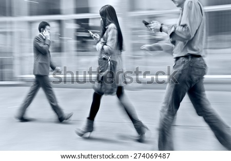 abstract image of business people in the street  modern style  with a blurred background and blue tonality - stock photo
