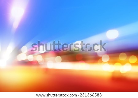 Abstract image of car lights in motion at dusk. - stock photo