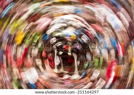 Abstract image of chewed wads of gum on the landmark gum wall at the Pike Place Market in Seattle that is formed by a circular motion blur. (Note: Soft focus results from motion blur.) - stock photo