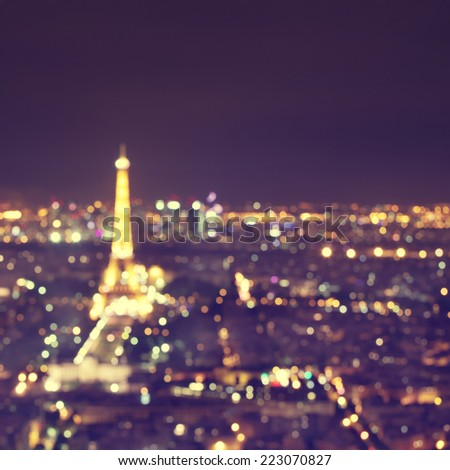Abstract image of defocused lights of night Paris. - stock photo
