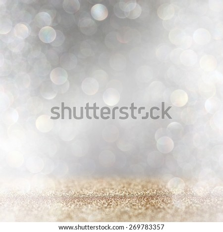 abstract image of glitter vintage lights background with light burst . silver, gold and white. de-focused.  - stock photo