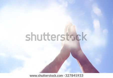 abstract image of male hands reaching for the sky. room for text. double exposure. - stock photo
