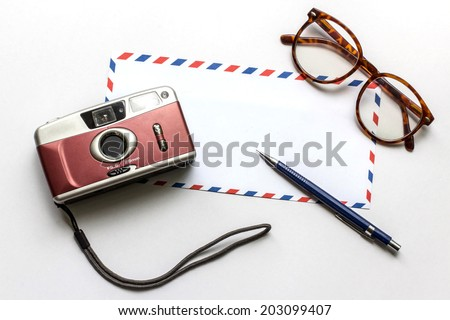 abstract image of Memory , film camera ,glasses ,pen and envelope on white background - stock photo